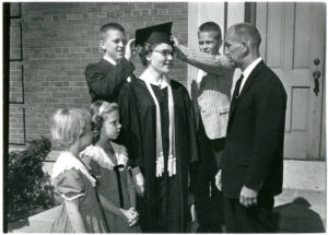 Graduate and family in front of Nyvall Hall, circa 1965 (image credit: CAHL 6754)